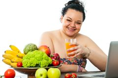 Overweight girl with organic food. Overweight teen with organic food bowl and fruit juice.Isolated on white background stock image