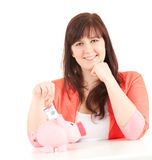 Overweight girl with piggy bank and dollars Stock Photography