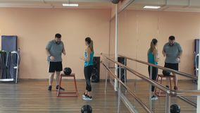 Personal training from athletic girl for fatboy with big abdomen in sportswear. Fat man training with woman instructor. Overweight male and female trainer with stock video