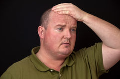 Overweight male with a sore head pain Stock Photo