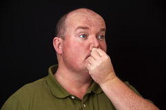Overweight male with a sore nose sinus issue Stock Photos