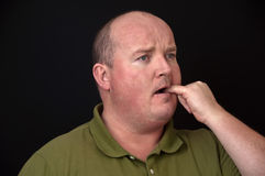 Overweight male with a sore wisdom tooth. Photo of overweight male with a sore wisdom tooth royalty free stock images