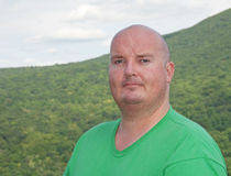 Overweight male sweating after mountain hike. Photo overweight male sweating after mountain hike Royalty Free Stock Images