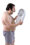 Overweight man. With the weight scale Royalty Free Stock Photo