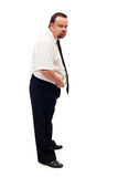 Overweight man assessing his problem. Holding belly in discontent - isolated Stock Images