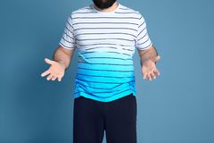 Overweight man on background. Overweight man on color background Stock Images