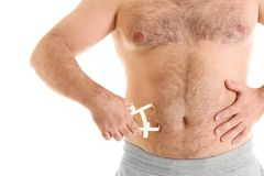 Overweight man with caliper. On white background Stock Images