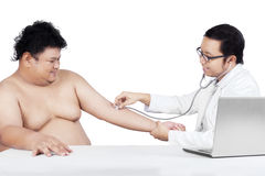Overweight man check up to doctor 2 Royalty Free Stock Photo