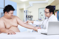 Overweight man check up to doctor Royalty Free Stock Photo