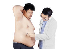 Overweight man checkup in hospital 2 Royalty Free Stock Photo
