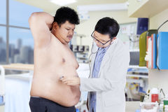 Overweight man checkup in hospital 1 Royalty Free Stock Image