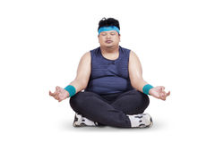 Overweight man doing meditation Stock Photography