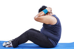 Overweight man doing sit-up Stock Image