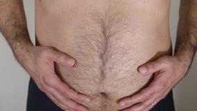 Overweight man dressing black pants stock video