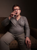 Overweight man drinking water Stock Photo