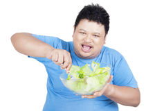 Overweight man eating a bowl of salad Royalty Free Stock Image