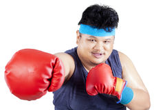 Overweight man exercise by boxing Stock Photography