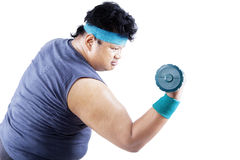 Overweight man exercising with dumbbell 1 Stock Photos