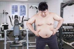Overweight Man Grabbing his Fat Stock Photos