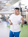 Overweight man in gym Royalty Free Stock Photography