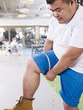 Overweight man in gym Royalty Free Stock Images