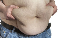 Overweight Man ipinching belly fat Stock Photo