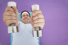 Overweight Man Lifting Dumbbells Stock Photography