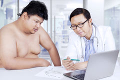 Overweight man looking at treatment result Stock Photo