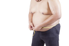 Overweight man measuring his stomach Stock Photos