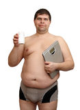 Overweight man with medicaments and scales Stock Photo