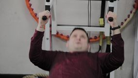 The overweight man pulls up on the horizontal bar. The overweight man pulls up on the horizontal bar stock footage