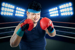 Overweight man ready to boxing Stock Images