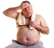 Overweight man resting, tired after training, with hand on foreh. Ead against white Stock Photos