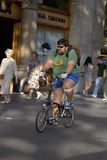 Overweight man riding bicycle on Passeig de Gr�cia in the Eixample district, busy street in Barcelona, Spain, Europe Royalty Free Stock Photos