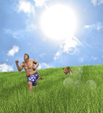 Overweight Man Running Faster Than Cheetah. Perhaps the best weight loss treatment of the year is to run under a big scorching sun with a cheetah cheering behind Royalty Free Stock Photography