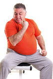 Overweight man showing his strength after doing exercises seted Stock Photos