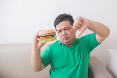 Overweight man stop eating junk food Royalty Free Stock Image