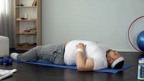 Overweight man trying to do sports exercise, strength and endurance development. Stock photo royalty free stock image