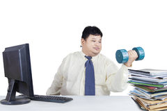 Overweight man working while workout Stock Images