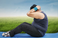 Overweight man workout outdoors royalty free stock photography