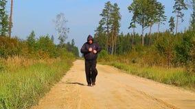 Overweight men take break of running stock footage
