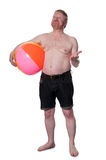 Overweight middle aged man with beach ball, checks for rain Stock Photos