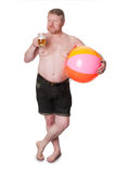 Overweight middle aged man with beach ball drinking beer Stock Photo