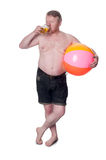 Overweight middle aged man with beach ball drinking beer Royalty Free Stock Photography