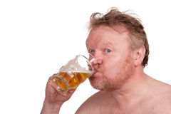 Overweight middle aged man with drinking beer Stock Photography