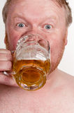 Overweight middle aged man with drinking beer Royalty Free Stock Images