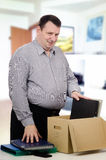 Overweight middle-aged man got a new job in the office Stock Image