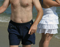 Overweight people at beach stock photo