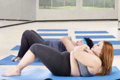 Overweight people exercise abdominal crunches Stock Image