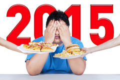 Overweight person avoid junk food Stock Photos